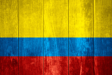 colombian: flag of Colombia or Colombian banner on wooden background
