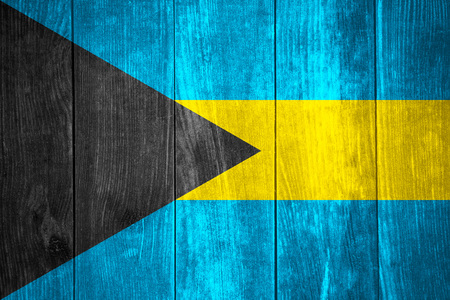 bahamian: flag of Bahamas or Bahamian banner on wooden background