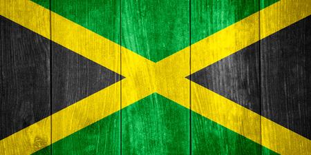 vlag van Jamaica of Jamaicaanse banner op houten achtergrond