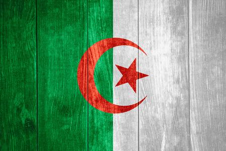 algerian flag: flag of Algeria or Algerian banner on wooden background Stock Photo