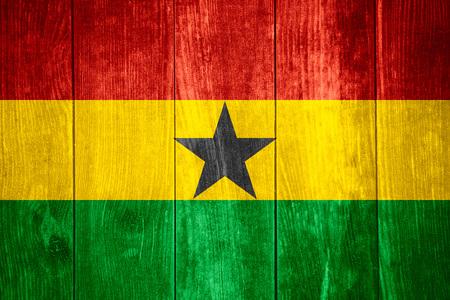Ghana: flag of Ghana or Ghanaian banner on wooden background