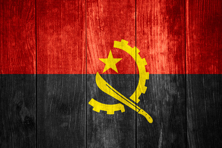 angola: flag of Angola or Angolan banner on wooden background