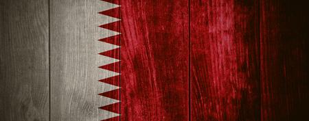 qatar: flag of Qatar or Qatari banner on wooden background Stock Photo