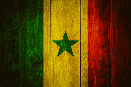 senegal: flag of Senegal or Senegalese banner on wooden background