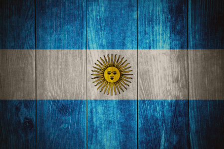 argentinian: flag of Argentina or Argentinian banner on wooden background Stock Photo