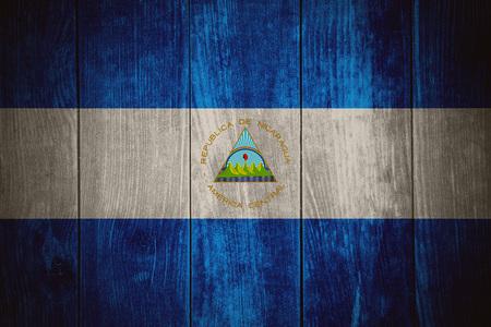 nicaraguan: flag of Nicaragua or Nicaraguan banner on wooden background