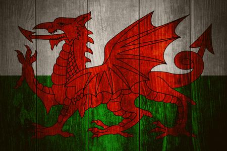 welsh flag: flag of Wales or Welsh banner on wooden background