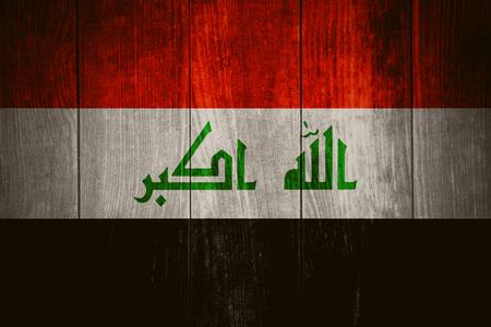 iraq: flag of Iraq or Iraqi banner on wooden background