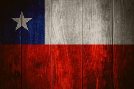 bandera chilena: flag of Chile or Chilean banner on wooden background Foto de archivo