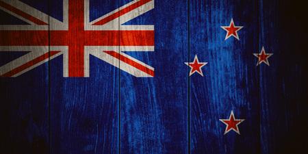bandera de nueva zelanda: flag of New Zealand or New Zealander banner on wooden background Foto de archivo