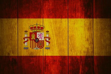 spainish: flag of Spain or Spanish banner on wooden background Stock Photo