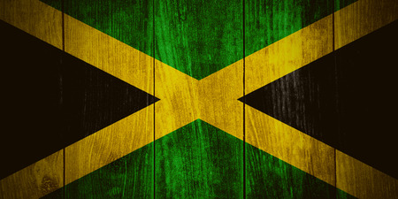 jamaican: flag of Jamaica or Jamaican banner on wooden background