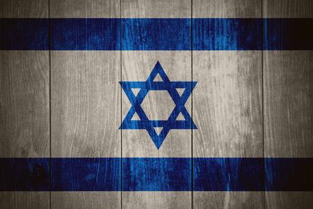 israeli: flag of Israel or Israeli banner on wooden background