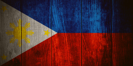 flag of Philippines or banner on wooden background
