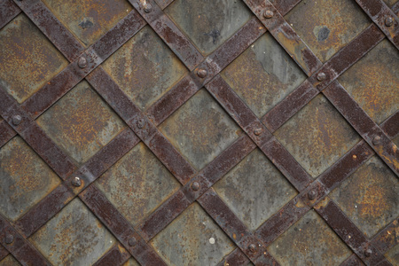 grid pattern: detail of old steel door or grid pattern vintage background Stock Photo