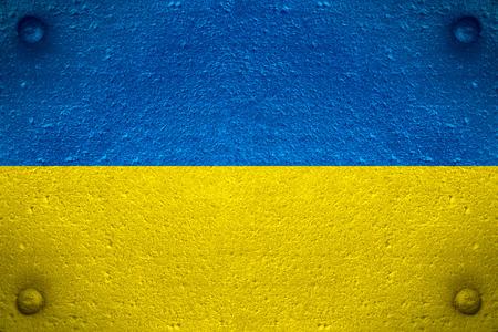 flag of Ukraine or Ukrainian banner on steel background Фото со стока