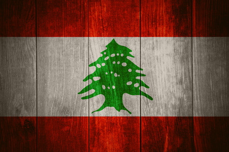 lebanese: flag of Lebanon or Lebanese banner on wooden background Stock Photo