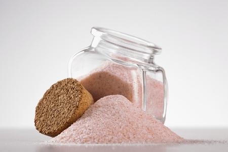 himalayan: pink Himalayan salt in glass jar on white background