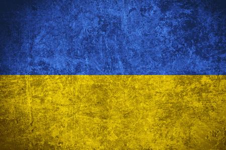 flag of Ukraine or Ukrainian banner on scratched vintage texture
