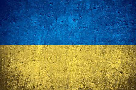 flag of Ukraine or Ukrainian flag on scratched rough texture