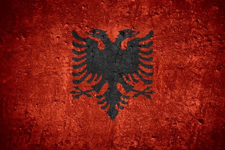 flag of Albania or Albanian flag on scratched rough texture
