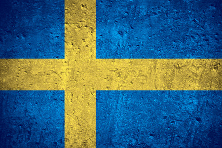 flag of Sweden or Swedish flag on scratched rough texture Фото со стока