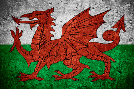 flag of Wales or Welsh flag on scratched rough texture