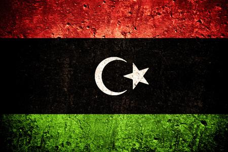 vlag van Libië of Libische vlag op gekraste ruwe textuur