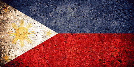 flag of Philippines or Philippine flag on scratched rough texture