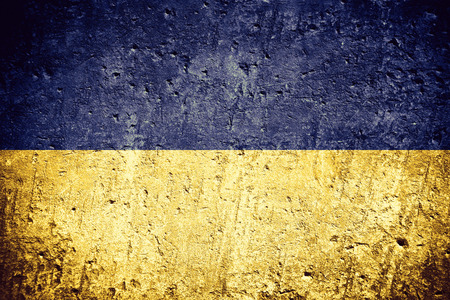 flag of Ukraine or Ukrainian banner on scratched rough texture Фото со стока