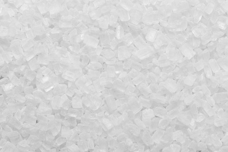 white granulated sugar texture or salt granule background
