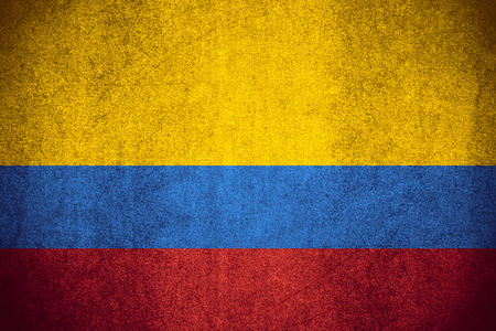 flag of Colombia or Colombian banner on rough pattern texture Banco de Imagens