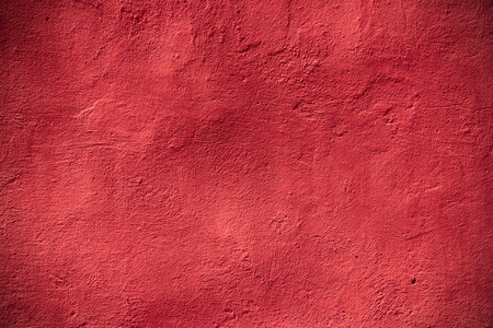 vintage abstract crimson background or rough pattern red plaster texture