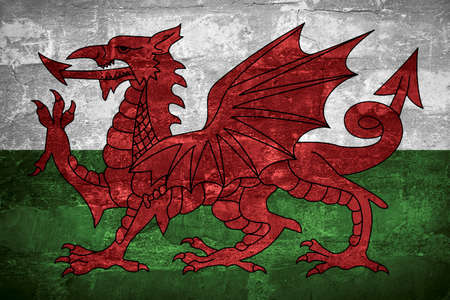 Flag of Wales or Welsh banner on wall background