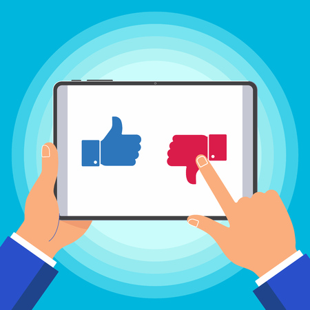Hand holding black tablet device isolated on blue background. Pad tablet on human hands with like dislike icons. Illustration