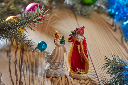 'grandfather frost': Christmas card background Santa Claus and Snow Maiden Russian Christmas characters: Ded Moroz (Father Frost) and Snegurochka (Snow Maiden) with gifts bag
