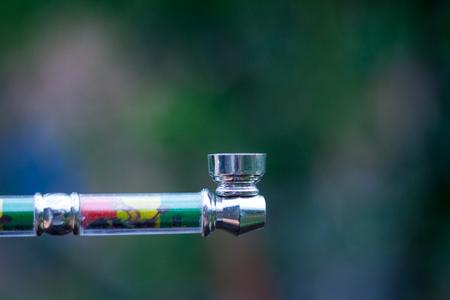 pipe for smoking medical marijuana a bunch of dry medicinal cannabis marijuana intended for smoking for medical purposes rastafaray hippi