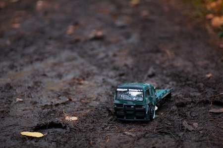 baby little truck car in the mud in the woods