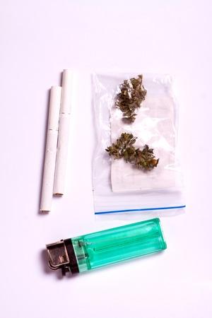 hemp buds with a smoking tube for medical marijuana and cannabis seeds for hemp oil