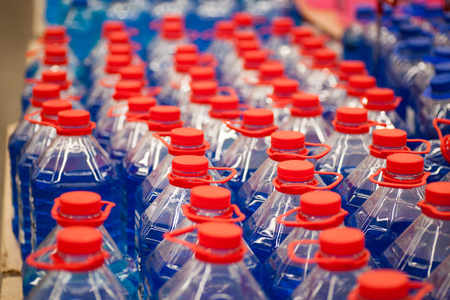 Plastic canister with nonfreezing liquid for washing of windows,Winter anti-free windscreen washer for car windows of bottle with blue liquid in autoshop for sale Stock Photo