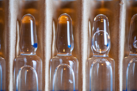 ampoules with medicine horizontal perspective view of many brown ampoules set in pharmaceutical packaging white container