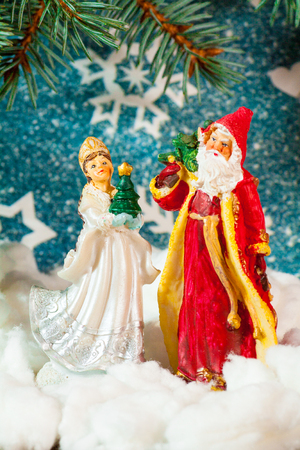 Christmas card background Santa Claus and Snow Maiden Russian Christmas characters: Ded Moroz Father Frost and Snegurochka Snow Maiden with gifts bag