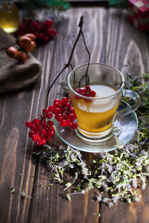 Herbal vitamin herbal tea with thyme in a transparent glass mug on a wooden table Stock Photo