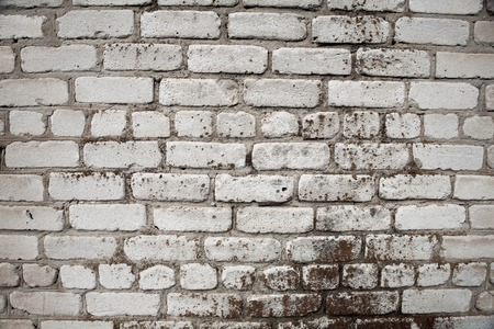 old brick wall of white brick with cement seams texture