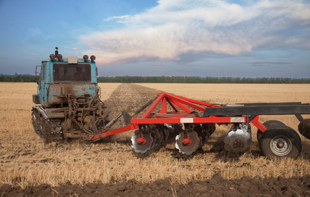 Farmer in tractor preparing land with sowing seedbed cultivator Stok Fotoğraf
