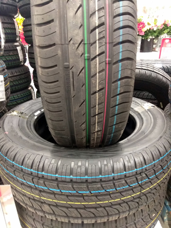 Sale of new summer tires for the car for the warm season in the auto shop and supermarket. Warehouse new summer tires.
