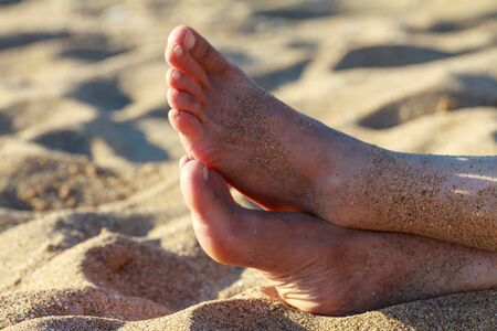 young girls toes are healthy and beautiful. Well-groomed toes. Concept for medical articles and ointments - the image of the toes and feet. Image of legs with space for inscriptions and advertising.
