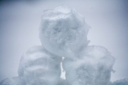 real snowballs with their hands clasped from the fresh snow in winter on the street Imagens - 131203833