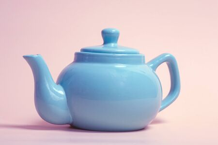 Elegant retro ceramic and clay teapot for brewing tea and steaming herbs for weight loss