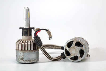 Light bulbs for car lamps. Automotive part in Silvery metallic and black color with wires and connecting elements